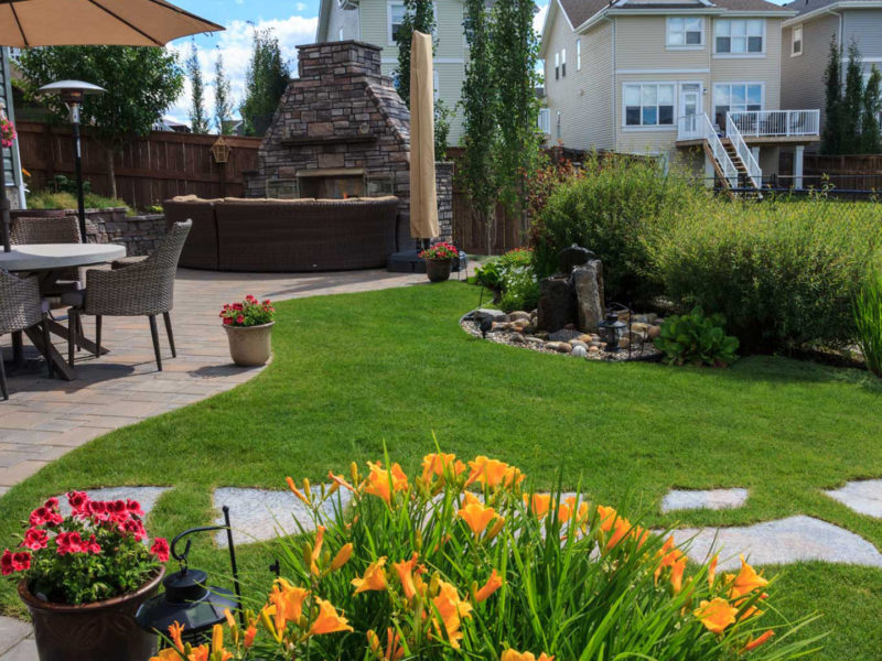 Calgary Landscaping Portfolio Yard In Auburn Bay With An Outdoor Fireplace