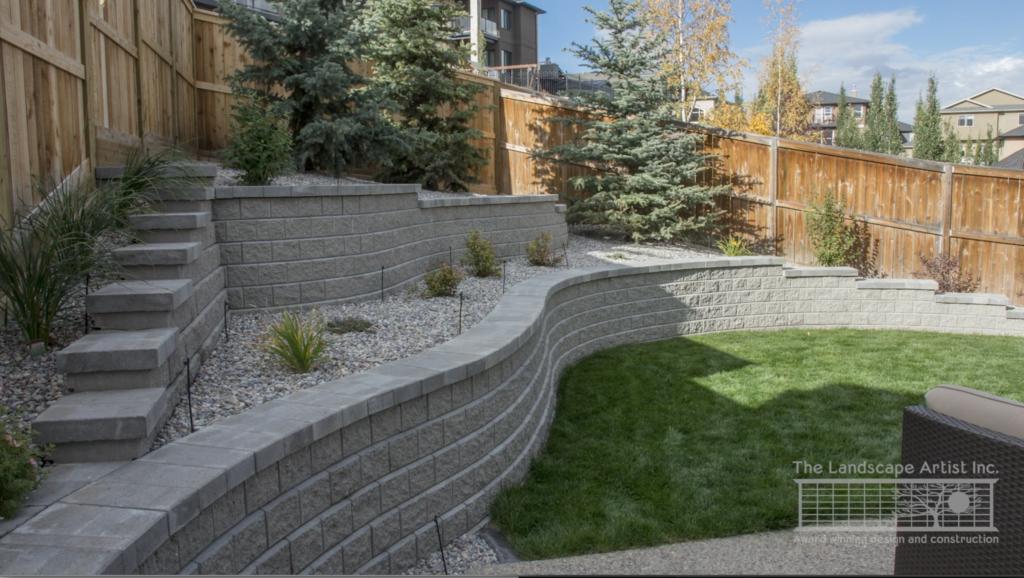 Curved retaining wall in Calgary backyard