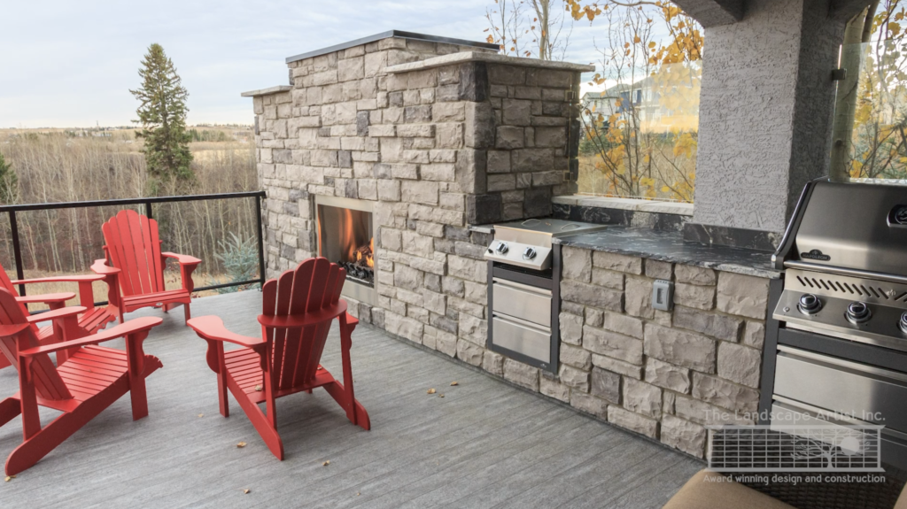 outdoor kitchen and fireplace built onto the upper deck in Calgary yard