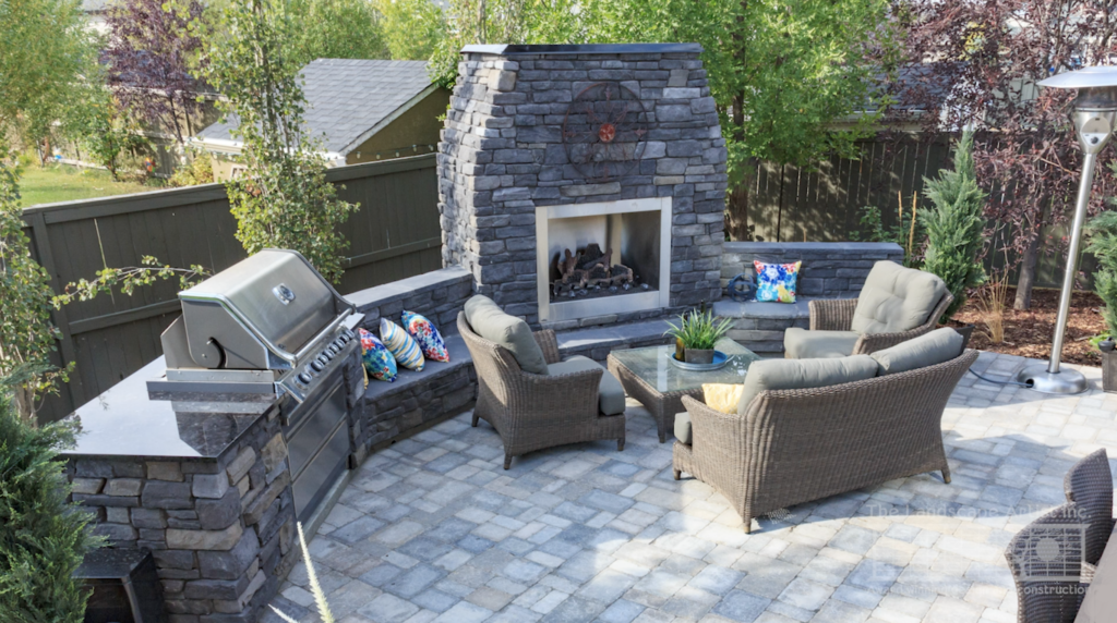 BBQ and outdoor fireplace in Calgary yard