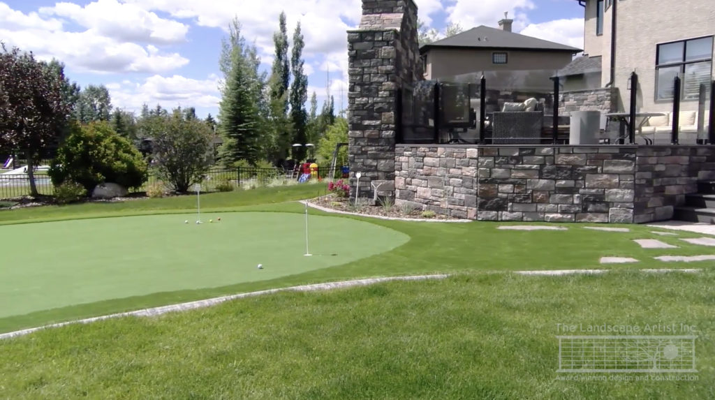 Landscape design includes a synthetic turf putting green by The Landscape Artist